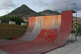 Deteriorated skate half pipe at sunset — Stock Photo