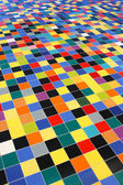 Diagonal perspective of colorful mosaic tiles pattern on a wall — Stock Photo