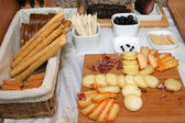 Assorted cheese and cookies — Stock Photo
