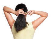 Woman gathers her hair — Stock Photo