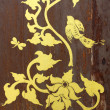Gold painting on old wood door — Stock Photo