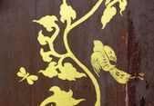 Gold painting on wood texture — Stock Photo