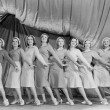 Portrait of line of female dancers on stage - Stockfoto