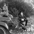 Woman and chauffer after car accident in country — Stok fotoğraf