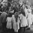 Santa Claus visiting with large group of children — Stock Photo #12288695