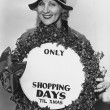 Woman with sign with number of shopping days until Christmas — Stock Photo #12288716