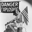 Portrait of woman with American flag and explosives — Stock Photo #12288804