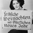 Royalty-Free Stock Photo: Portrait of woman holding sign written in German