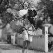 Woman carrying live turkey and grocery basket — Photo