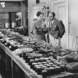 Couple with table covered in food for holiday meal — Εικόνα Αρχείου #12288851