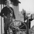 Portrait of craftsman with wooden wheel — Photo