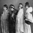 Portrait of four young women posing in shawls — Stockfoto