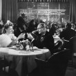 Couple dining in crowded restaurant — Stockfoto
