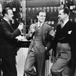 Stock fotografie: Businessmen drinking together at bar