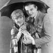 Portrait of couple under umbrella — Photo