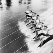 Row of women water skiing — Stok fotoğraf