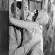 Couple kissing through bars of jail cell — Stok fotoğraf