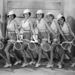 Stock Photo: Row of female tennis players in matching outfits