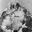 Triumphant woman at mountain summit — Stock Photo