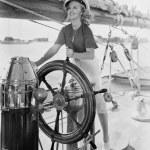 Portrait of woman steering boat — Stock Photo