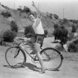 Male bicyclist waving — Stockfoto #12289678
