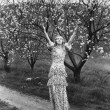 Woman with flowering trees - Foto Stock