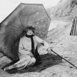 Stock Photo: Woman with umbrella at beach