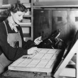 Woman working in printing shop — Stock Photo