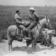 Cowboy and businessman playing checkers on horseback — Stock Photo