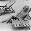 Stock Photo: Womplaying backgammon on beach