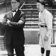Baseball player and umpire — Stock Photo