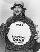 Mujer con cartel con el número de días de compras hasta navidad — Foto de Stock