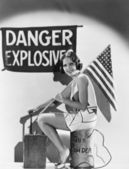 Portrait of woman with American flag and explosives — Stock Photo