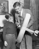 Brothers with model airplane — Stock Photo