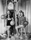 Women with balloons on New Years Eve — Stock Photo