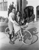 Portrait of couple on bicycle together — Stock Photo