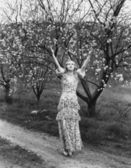 Woman with flowering trees — Stock Photo