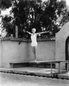 Woman on diving board at swimming pool — Stock Photo