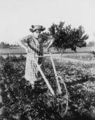 Woman using walking plow in garden — Stock Photo