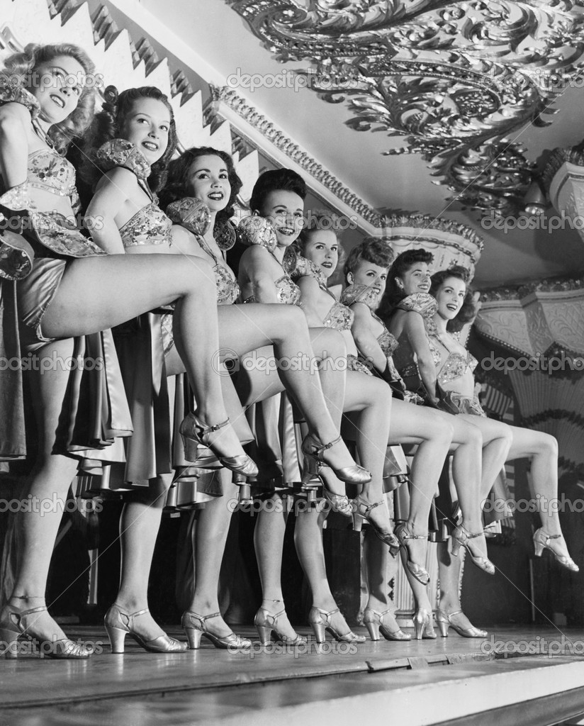 Chorus line of women with legs lifted — Stock Photo #12288625