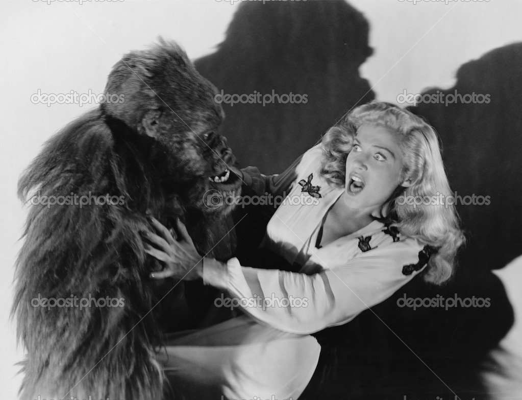 Terrified woman being attacked by gorilla — Stock Photo #12288641