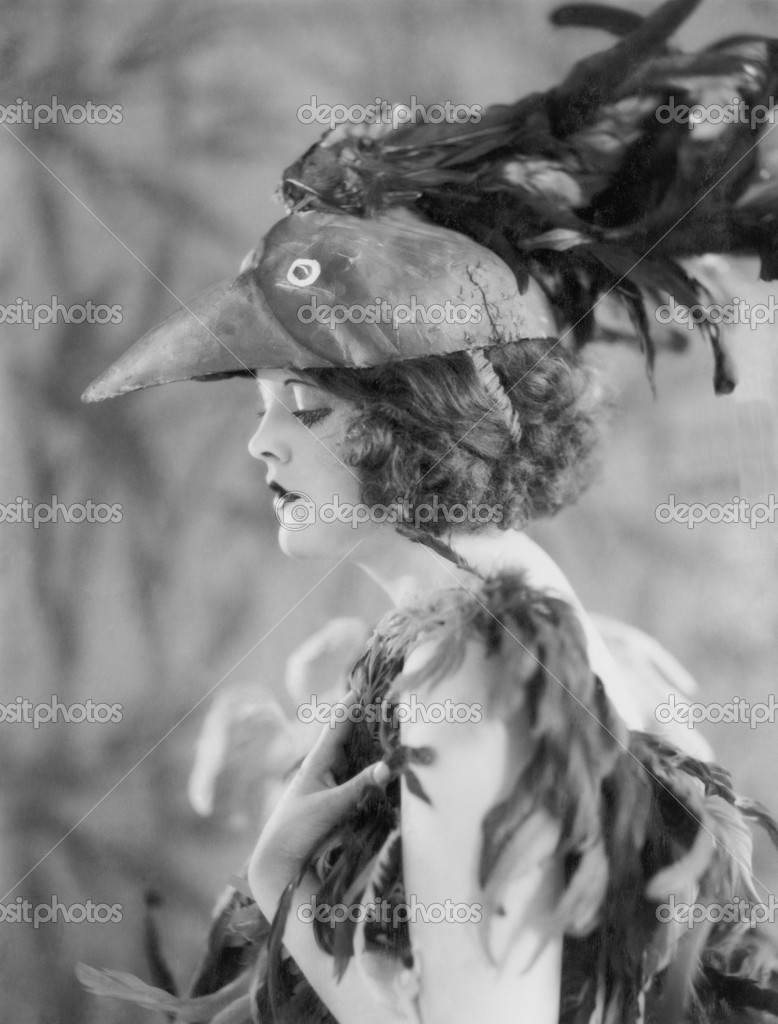 Portrait of woman wearing bird costume — Stock Photo #12289084