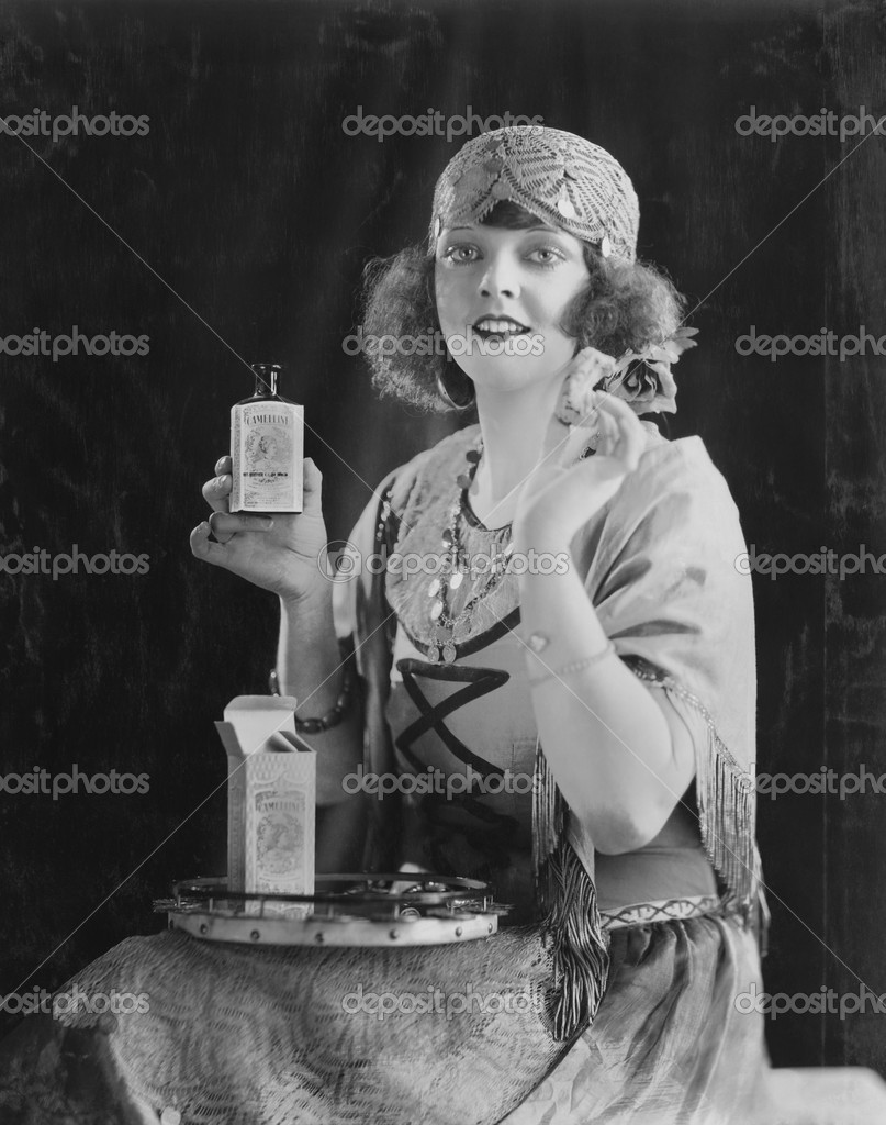 Portrait of woman using beauty product — Stok fotoğraf #12289109