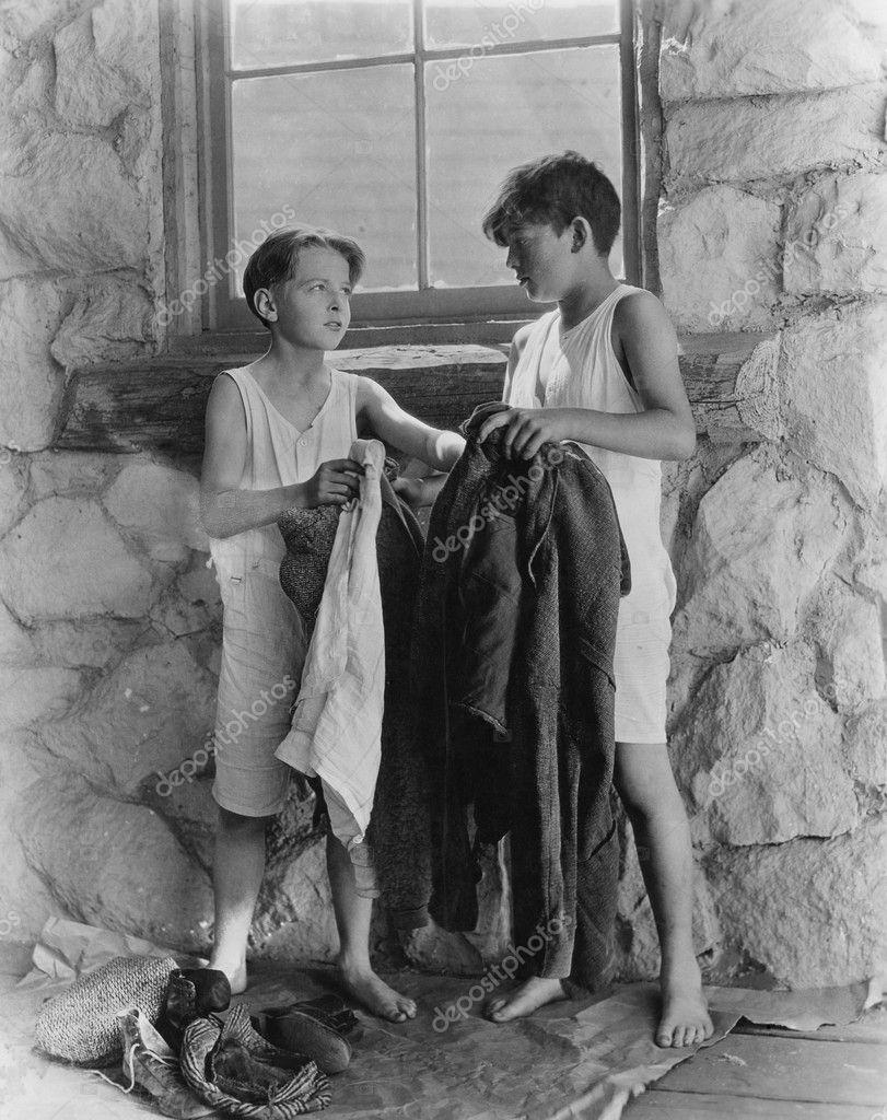 Boys removing their clothes outside u2014 Stock Photo u00a9 everett225 #12289324