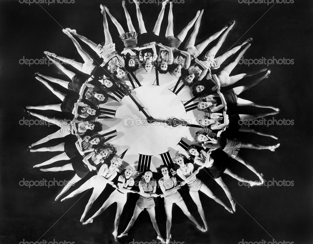 Female dancers circling huge clock  Stock Photo #12289501
