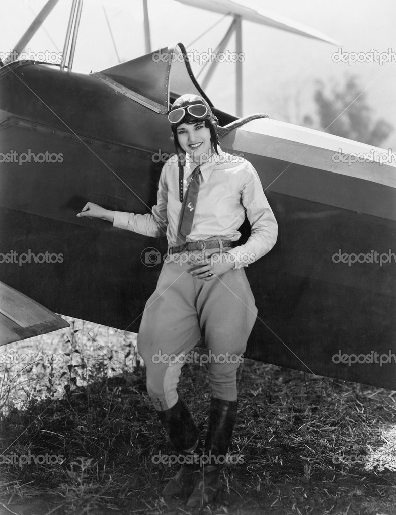 Portrait of female aviator with plane — Stock Photo #12289623