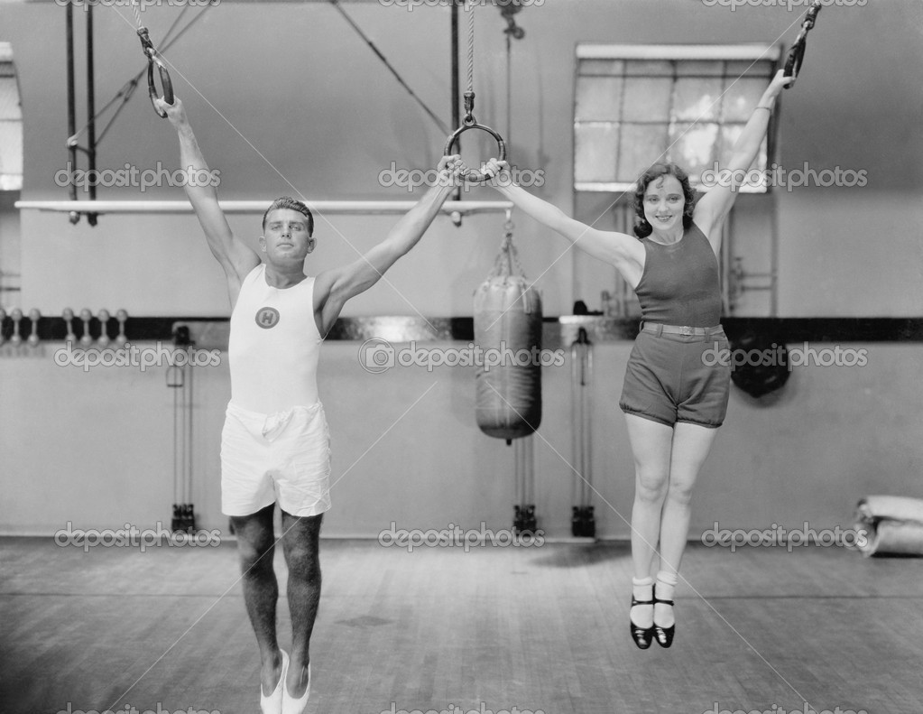 Athletes on rings in gym — Stock Photo #12289646
