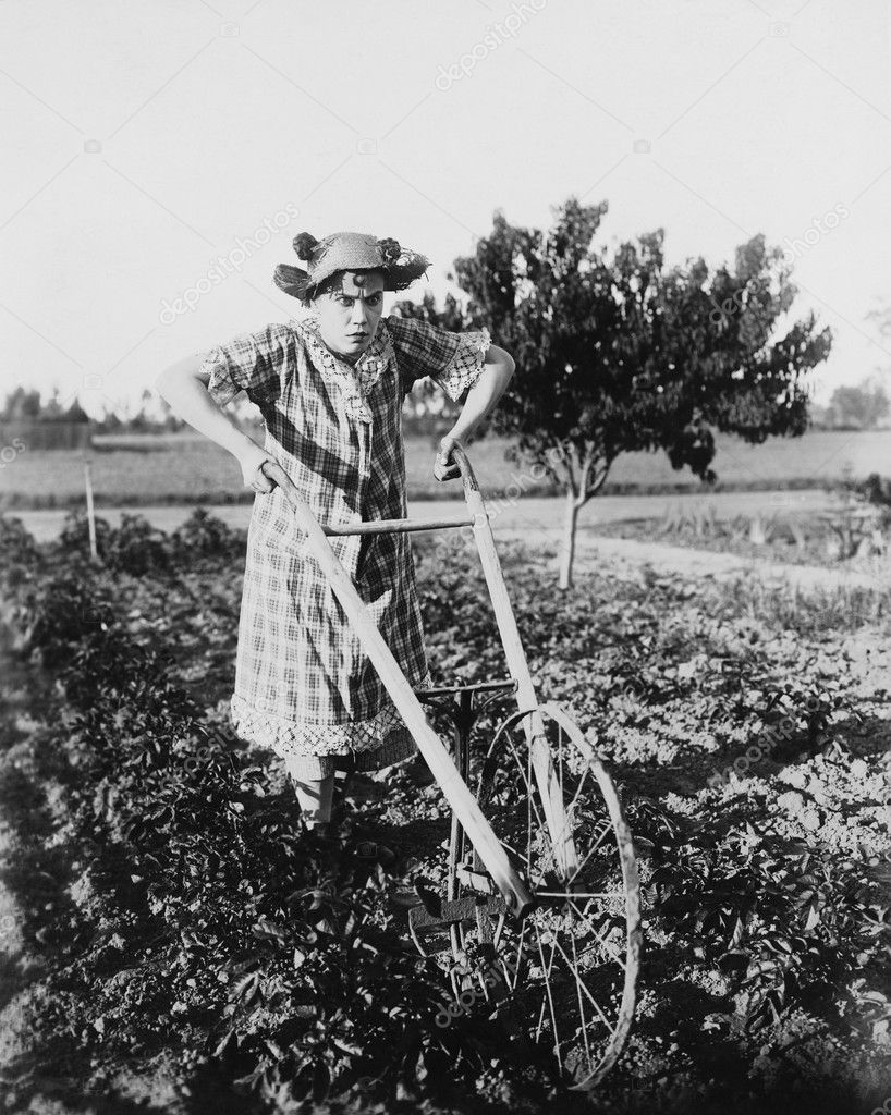 Woman using walking plow in garden — Stock Photo #12289798