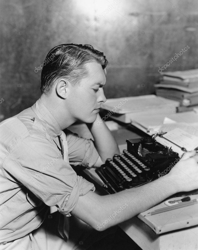 Man using typewriter  Stock Photo #12289894