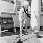 Female sailor swabbing boat deck — Stock Photo #12290056